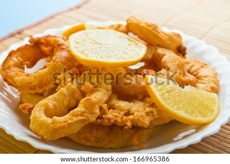 fried squid rings dipped in batter - stock photo