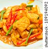 Fried squid with salted egg yolk is the food that Thais popular eating. - stock photo