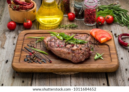 fried steak on bone, on a wooden table