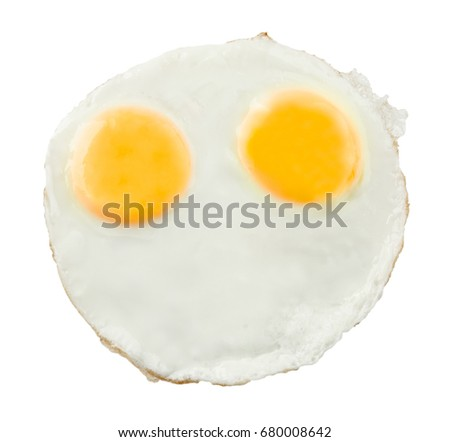 Fried sunny side up eggs on white background