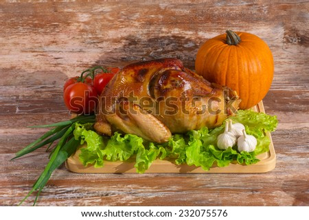 fried turkey with vegetables  on a wooden background - stock photo