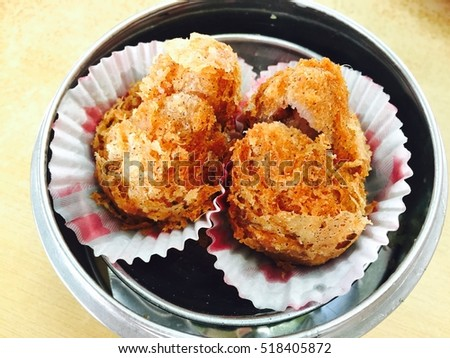 Fried yam dim sum inside silver round plate, Chinese foods, crispy snack