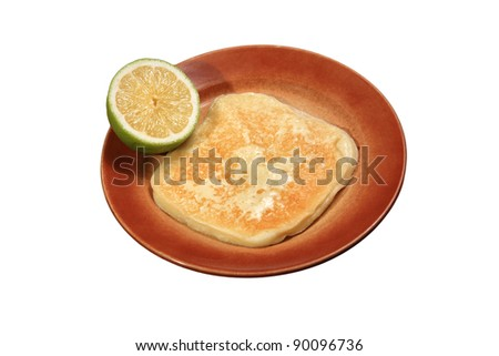 fried yellow cheese served with lemon