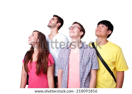 Friend group of happy students look up forward isolated over a white background,  caucasian and asian - stock photo