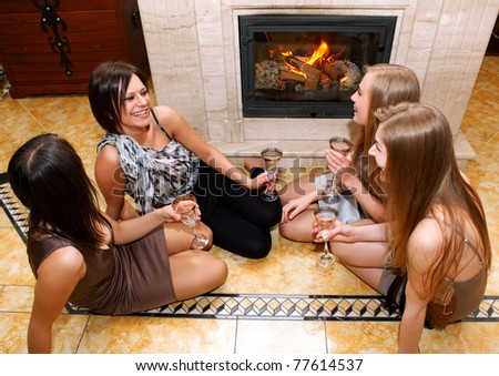 friend sitting beside the fireplace I will place conversing - stock photo