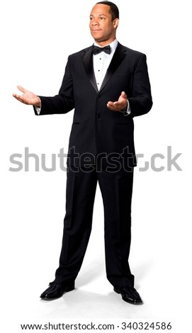 Friendly African man with short black hair in evening outfit pointing using palm - Isolated