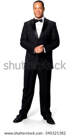 Friendly African man with short black hair in evening outfit with clasped hands - Isolated
