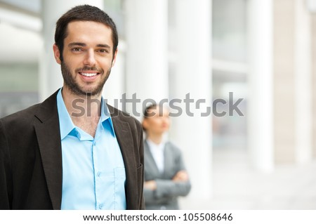 Friendly and smiling businessman looking at camera - stock photo
