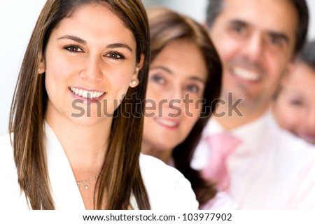 Friendly business team at the office looking very happy - stock photo