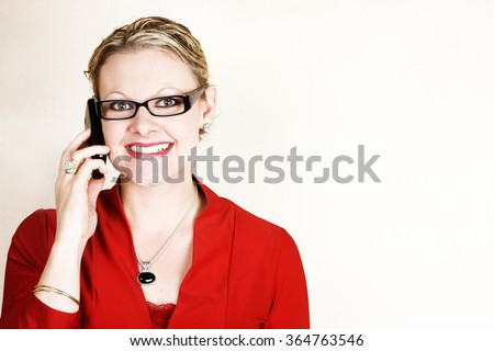 Friendly business woman on her cell phone