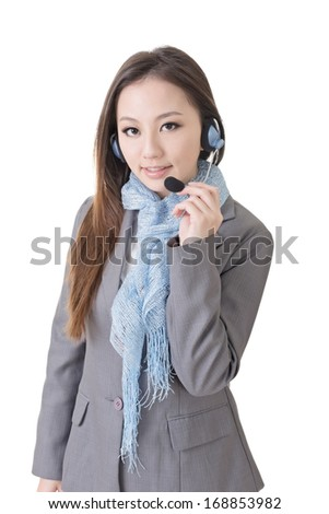 Friendly business woman with a headphone, closeup portrait on white background.