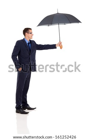 friendly businessman giving umbrella on white background - stock photo