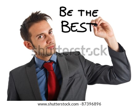 Friendly businessman writing a motivational concept on the screen