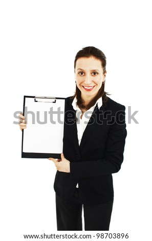 Friendly businesswoman holding a blank clipboard. Isolated on white background - stock photo