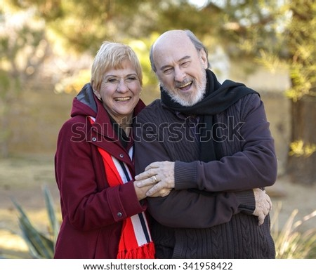 Friendly Caucasian elderly men with short red hair cuddling - stock photo