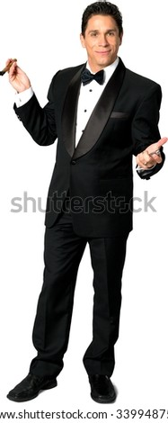 Friendly Caucasian man with short black hair in a tuxedo using cigar - Isolated - stock photo