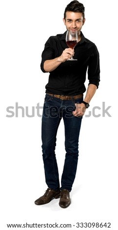 Friendly Caucasian man with short black hair in casual outfit holding wine glass - Isolated