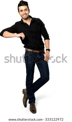 Friendly Caucasian man with short black hair in casual outfit leaning - Isolated