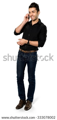 Friendly Caucasian man with short black hair in casual outfit using mobile phone - Isolated