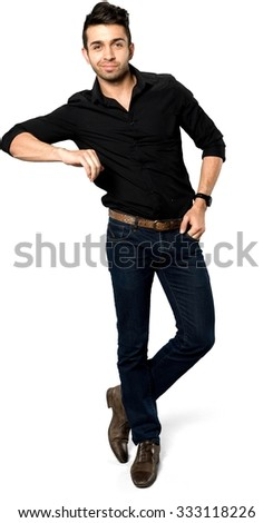 Friendly Caucasian man with short black hair in casual outfit with hands in pockets - Isolated