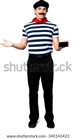Friendly Caucasian man with short black hair in costume holding mobile phone - Isolated - stock photo