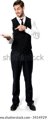 Friendly Caucasian man with short dark brown hair in business casual outfit holding invisible object - Isolated