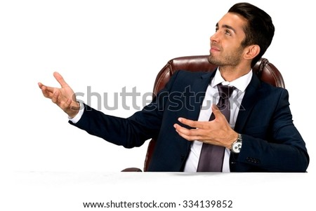 Friendly Caucasian man with short dark brown hair in business formal outfit pointing using palm - Isolated