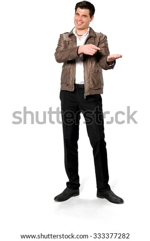 Friendly Caucasian man with short dark brown hair in casual outfit holding invisible object - Isolated