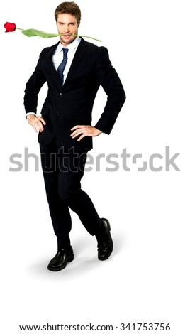 Friendly Caucasian man with short medium blond hair in business formal outfit holding flower - Isolated