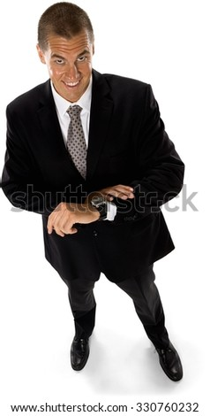 Friendly Caucasian man with short medium brown hair in business formal outfit holding wristwatch - Isolated