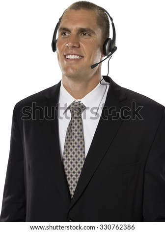 Friendly Caucasian man with short medium brown hair in business formal outfit using headset - Isolated