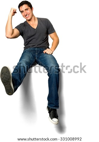 Friendly Caucasian young man with short black hair in casual outfit with hands on thighs - Isolated - stock photo