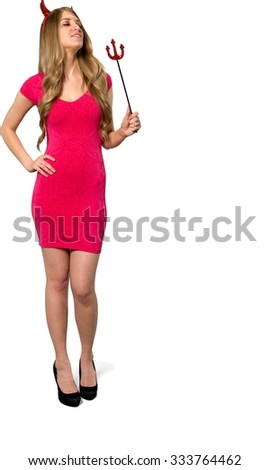Friendly Caucasian young woman with long light blond hair in evening outfit holding devil fork - Isolated