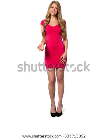 Friendly Caucasian young woman with long light blond hair in evening outfit with hands on thighs - Isolated