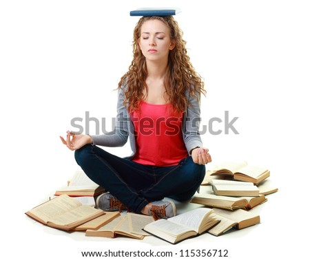 Friendly College student girl sitting and meditating with books down the floor isolated