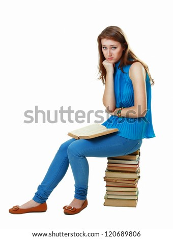 Friendly College student girl sitting on pile of books isolated - stock photo