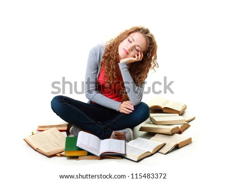 Friendly College student girl sleeping near books sitting down the floor isolated - stock photo