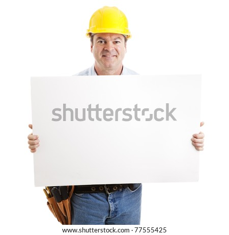Friendly construction worker holding a blank, white sign.  Isolated on white. - stock photo
