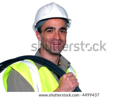 friendly construction worker with a cable on his shoulder looking into the camera