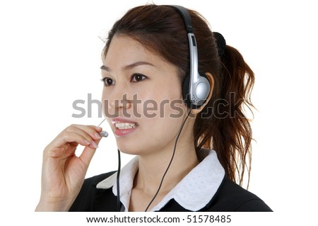 Friendly Customer Representative with headset smiling during a telephone conversation - stock photo