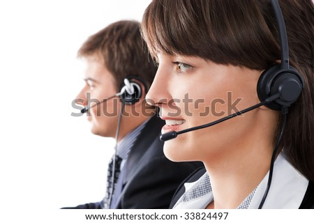 Friendly customer service team over a white background - stock photo