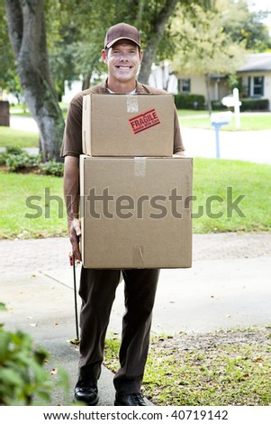 Friendly delivery man or mover bringing packages to your home. - stock photo