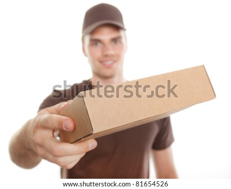 friendly deliveryman with package for you - stock photo
