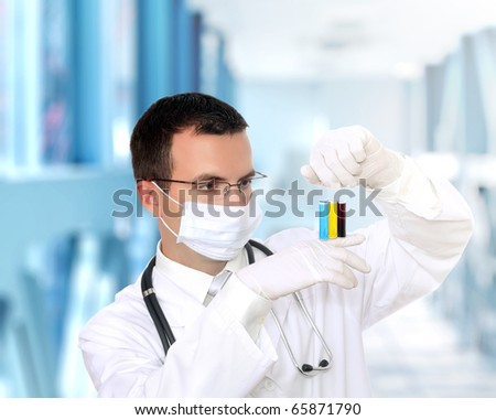 Friendly doctor in mask resarch a medical test glass .