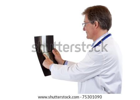 Friendly elderly doctor points to knee x-ray.Isolated on white background. - stock photo