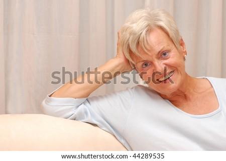 Friendly elderly lady - stock photo