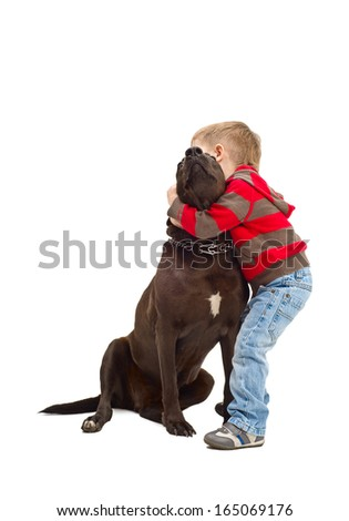 Friendly embraces a little boy and dog - stock photo