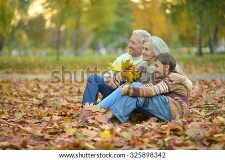 friendly family walking in the park in autumn together - stock photo