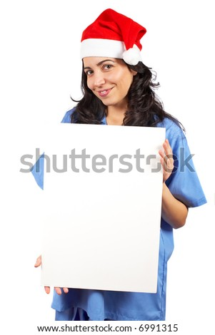 Friendly female doctor in blue scrubs with christmas hat, holding the blank banner on white background - stock photo