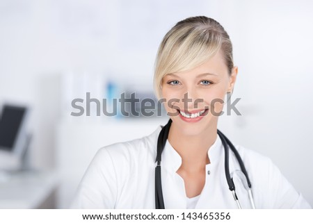 Friendly female doctor with wearing gown and stethoscope